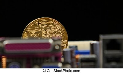 Gold bitcoin with motherboard. Rotation