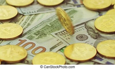 Gold bitcoins and dollars - Close-up shot of fortune...