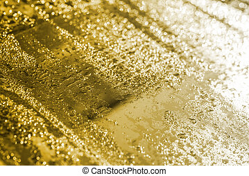 gold bokeh of dew on the glass