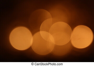 Gold bokeh on black background