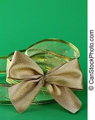 gold bow and ribbon on a green