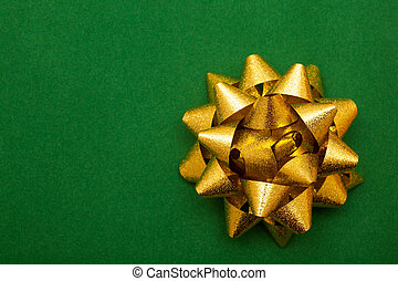 Gold bow on green background