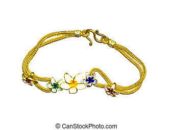 Gold bracelet with flower pattern on a white background.