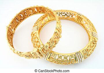 Gold Bracelets 1 - A pair of 22k gold bracelets in the Arab...