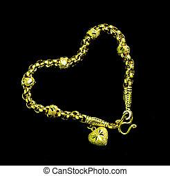 Gold bracelets arranged in a heart shape