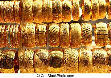 Gold Bracelets - several golden bracelets