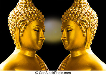 Gold Buddha isolated on black background