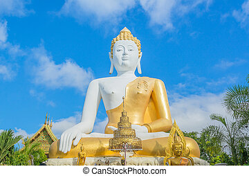 gold Buddha statue in temple of Thailand