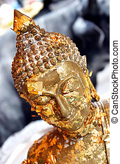Gold Buddhist statue - Close-up of a gold Buddhist statue in...
