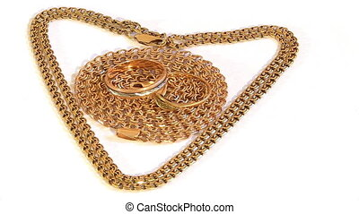 Gold chains and wedding rings rotate