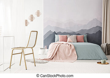 Gold chair in bright bedroom