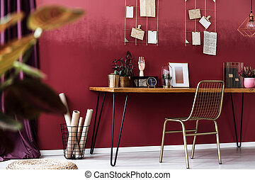 Gold chair in red interior