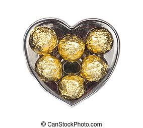 Gold chocolate in heart shape box isolated on white