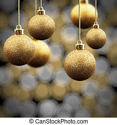 Gold Christmas balls on a multi coloured sparkling...