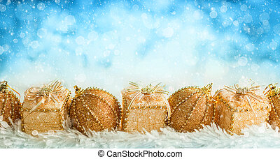 Gold Christmas baubles and gift boxes