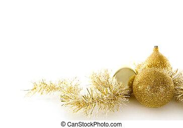 beautiful gold seasonal Christmas decorations on white background
