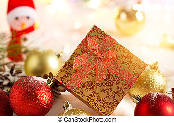 Gold Christmas gift boxes with snow