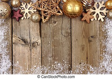 Gold Christmas ornament top border on rustic wood - Gold...