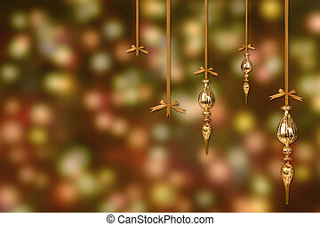 Gold Christmas Ornaments on a Blurry Lit Background