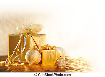 gold Christmas gifts with balls and candle on gold...