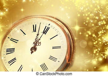 Gold clock showing midnight - New Year at midnight