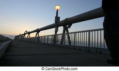 Gold Coast Pier Queensland - A man walks over the Gold Coast...