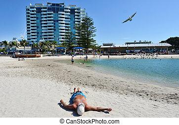 Australian man sunbathing