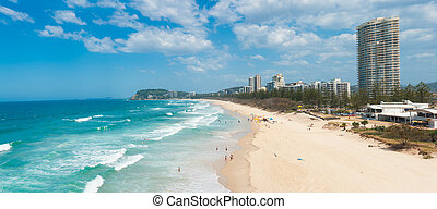 Gold Coast with a beach full of tourists seen from above....