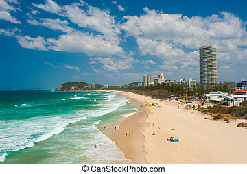 Gold Coast with a beach full of tourists seen from above. ...