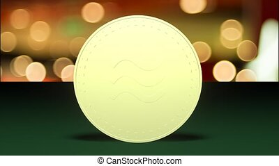 Gold coin of libra rotates on a green cloth, loop.