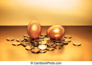 Gold coins and golden eggs, the concept of financial growth