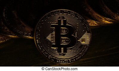 Gold coins bitcoin in the twinkling of light. Close up