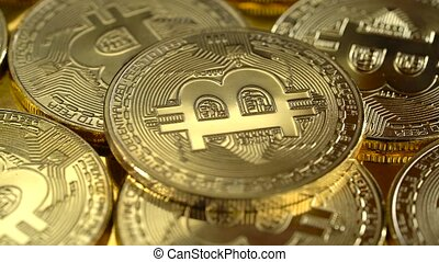 Gold coins cryptocurrency bitcoin spinning. Close up - Gold...