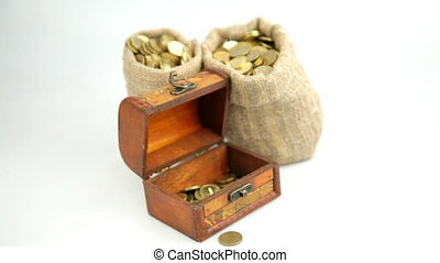Gold coins fall into a wooden box - Golden coins fall from...