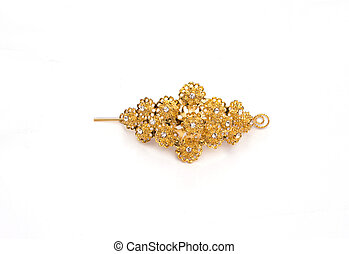 gold colour barrette on white background
