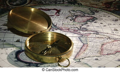 Gold compass, ancient map