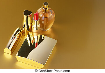 Gold cosmetic set - Cosmetic set. Gold powder, lipsticks and...