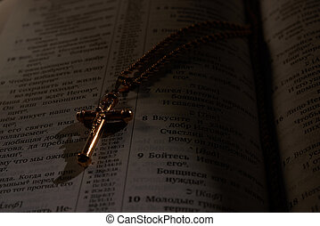 gold cross on a chain in the Bible