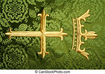 gold crown and cross over green background.