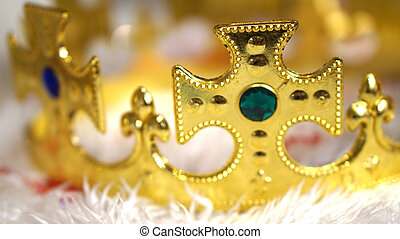 gold crown with diamond on white fur background