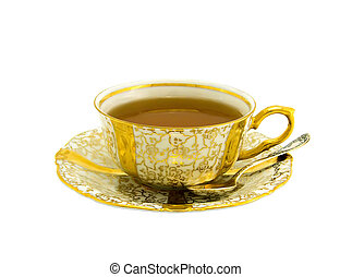 Gold cup with tea