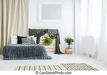 Gold curtain in bedroom interior