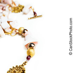 gold detail of bijouterie with semiprecious at white background
