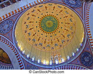 Gold dome ceiling in a mosque interior
