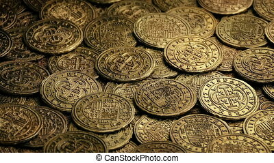 Gold Doubloons Pile Rotating - Closeup of ancient gold coins...