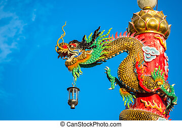 gold dragon on the red pole