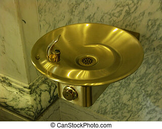 Gold Drinking Fountain - A decorative, gold drinking...