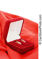 Gold earrings in a red box
