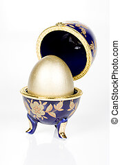 Gold egg in a glass eggcup