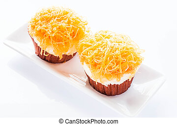 Gold egg yolk thread cakes isolated on white background